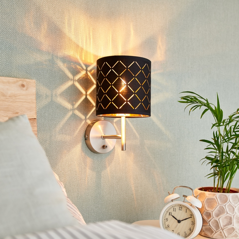 Black-gold wall light Julita with switch